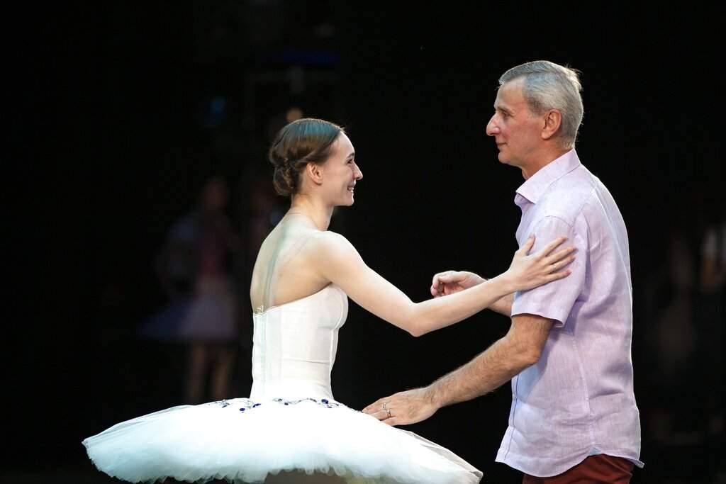 Ballerina Olga Smirnova speaks to the ballet director of the Bolshoi Theater Makhar Vaziev during conducting a rehearsal in the Bolshoi Theater in Moscow, Russia. (AP Photo/Alexander Zemlianichenko)