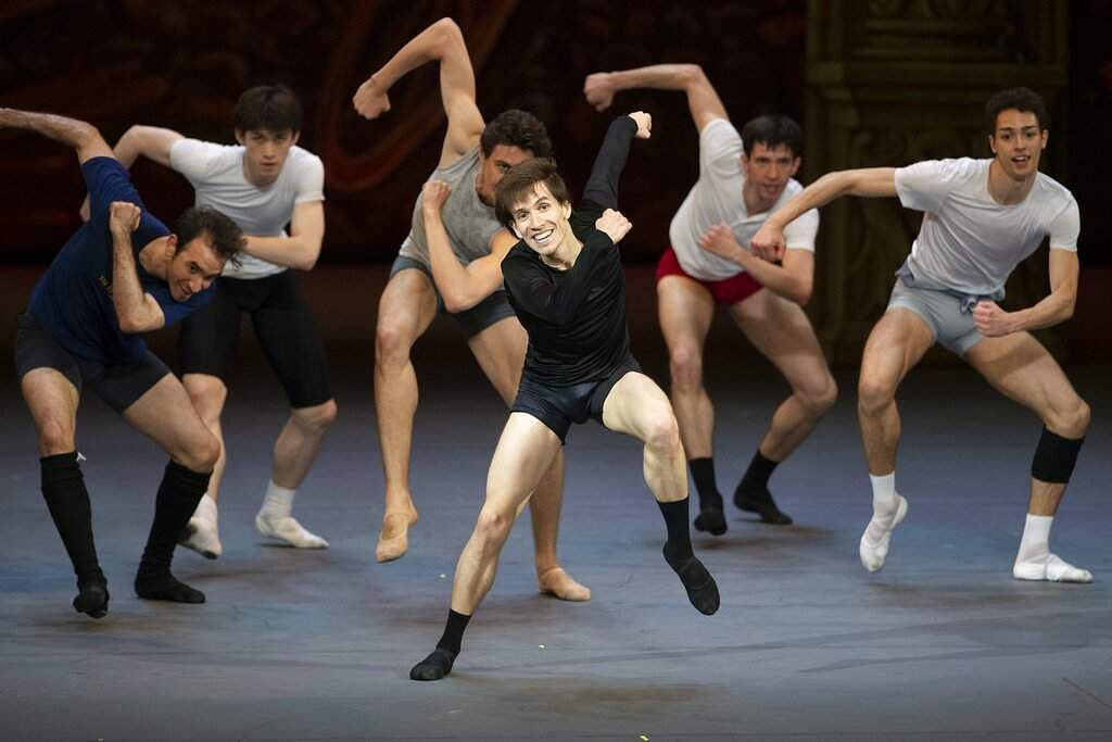 Georgy Gusev and other dancers perform during a rehearsal of Maurice Bejart's Gaiete Parisienne in the Bolshoi Theater in Moscow, Russia. (AP Photo/Alexander Zemlianichenko)