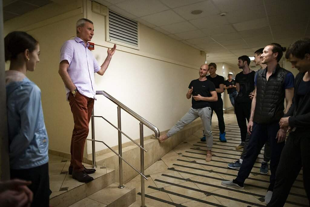 The ballet director of the Bolshoi Theater Makhar Vaziev talks with dancers at the Bolshoi Theater backstage in Moscow, Russia. (AP Photo/Alexander Zemlianichenko)