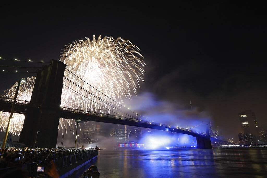 Fireworks light up the sky above the Brooklyn Bridge during Macy's Fourth of July fireworks show Thursday, July 4, 2019, in New York. (AP Photo/Frank Franklin II)AP19186065688303