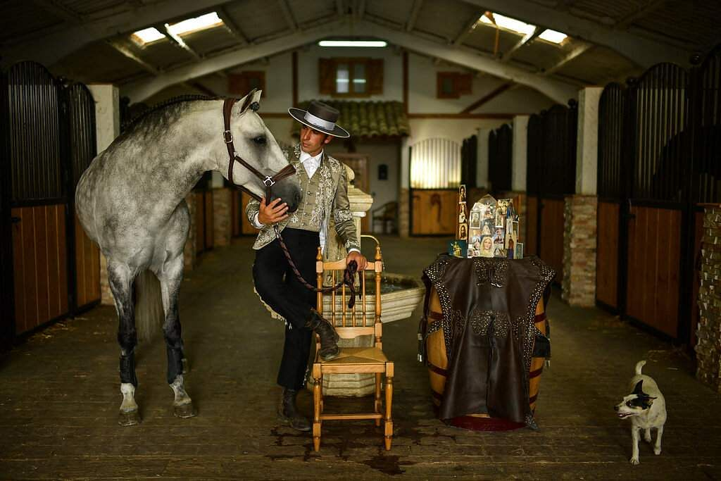 Roberto Armendariz, 33, Spanish 'rejoneador' or mounted bullfighter, poses with one of his horses known as Heroi, at his ranch in Noain, northern Spain. (AP Photo/Alvaro Barrientos)