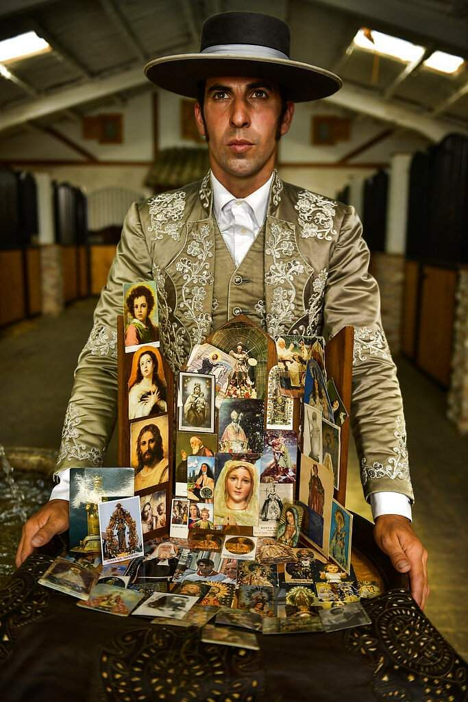 Roberto Armendariz, 33, Spanish 'rejoneador' or mounted bullfighter, poses with photos of saints and virgins that he prays to before every performance. (AP Photo/Alvaro Barrientos)