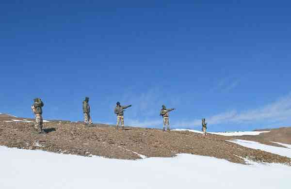 Indo-Tibetan Border Police (ITBP) personnel on snow ridges of Himalayas. (Photo: IANS/ITBP)