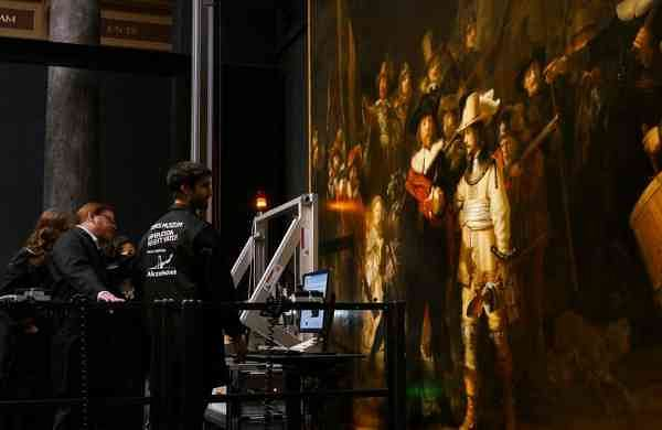 Technicians and researchers study Rembrandt's Night Watch masterpiece (AP Photo/Aleksandar Furtula)