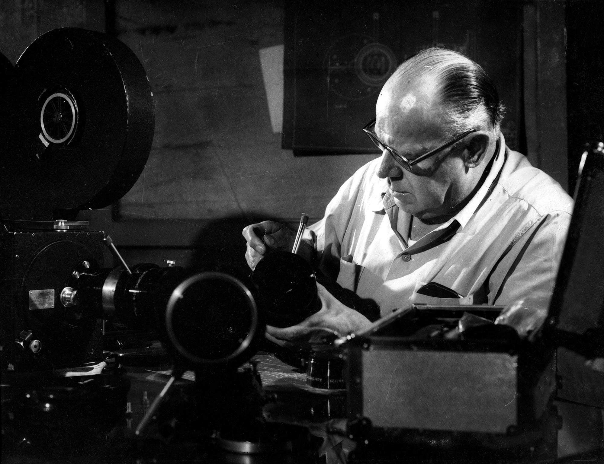 Josef Wirsching servicing his camera equipment at the Bombay Talkies studios, early-1950s