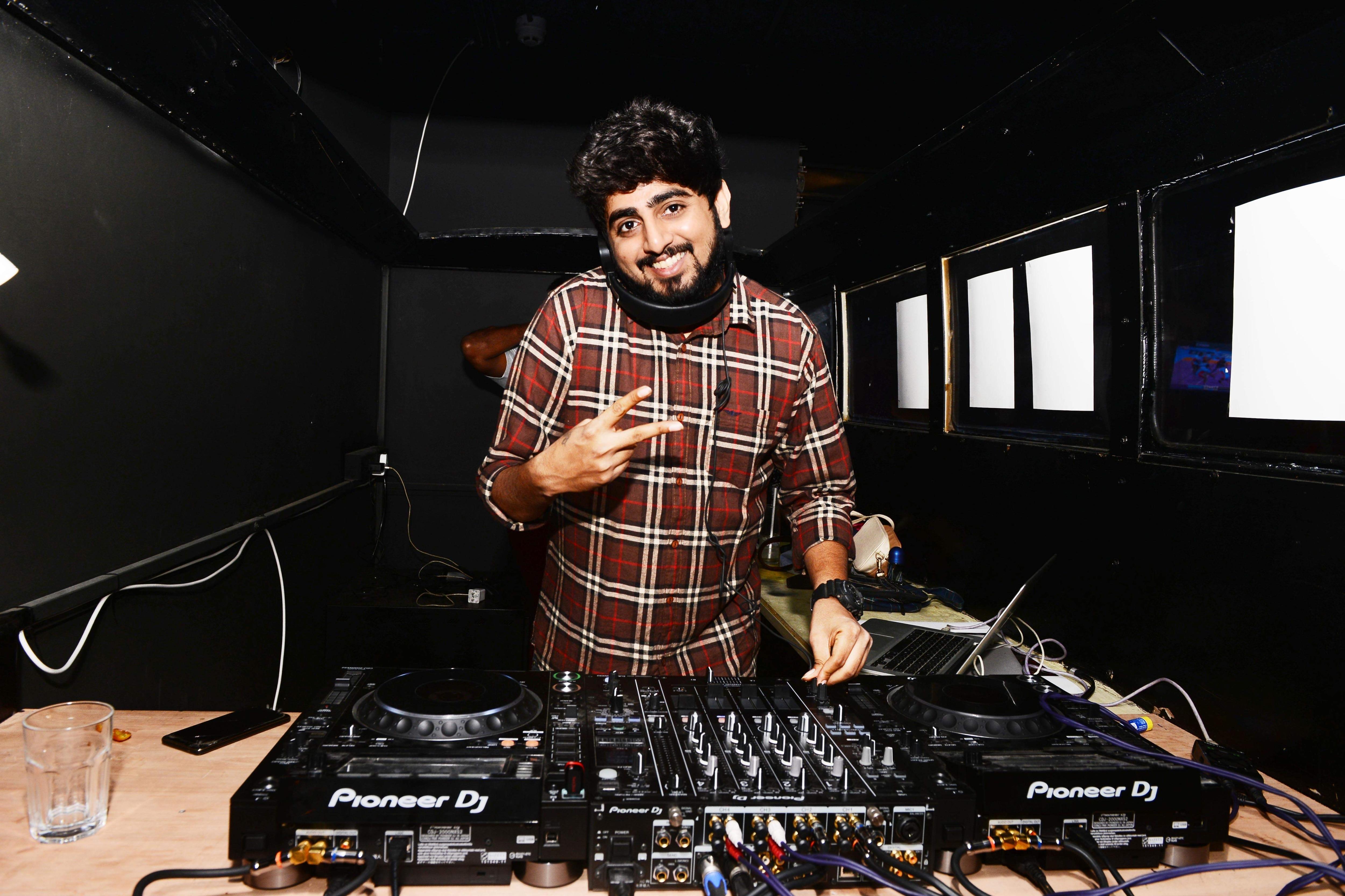DJ Arihant spinning the tunes at Mechanic's