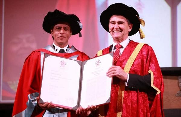 Shah Rukh Khan poses with his doctorate degree