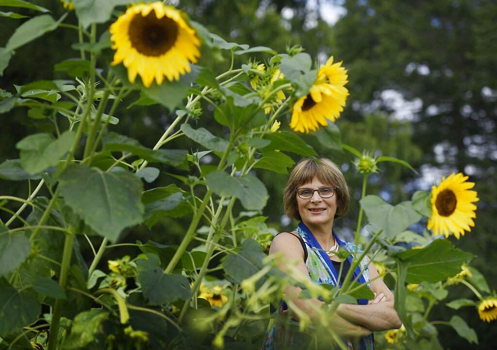 Karen Breda in a garden in West Hartford, Conn (AP Photo/Jessica Hill)