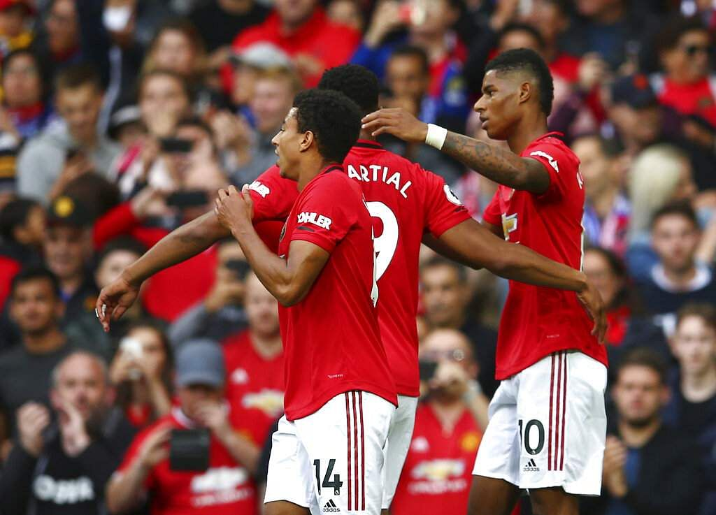 Manchester United's Marcus Rashford celebrates after scoring his side's first goal in the English Premier League match against Chelsea at Old Trafford in Manchester, Aug 11. (AP Photo/Dave Thompson)