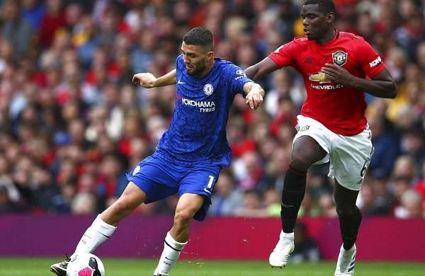 Man U's Paul Pogba challenges Chelsea's Mateo Kovacic. Manchester United beat Chelsea 4-0 to ruin Frank Lampard's debut as a Premier League coach in their season-opening game. (AP Photo/Dave Thompson)