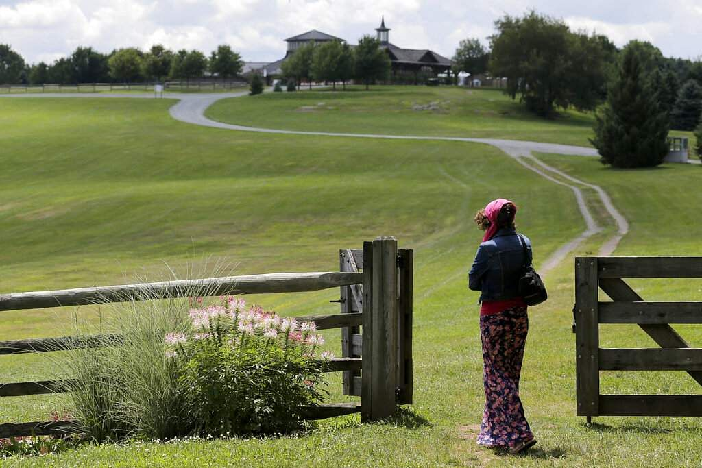 Carol Laura looks over the site of the 1969 Woodstock Music and Arts Fair, in Bethel, NY. (AP Photo/Seth Wenig)