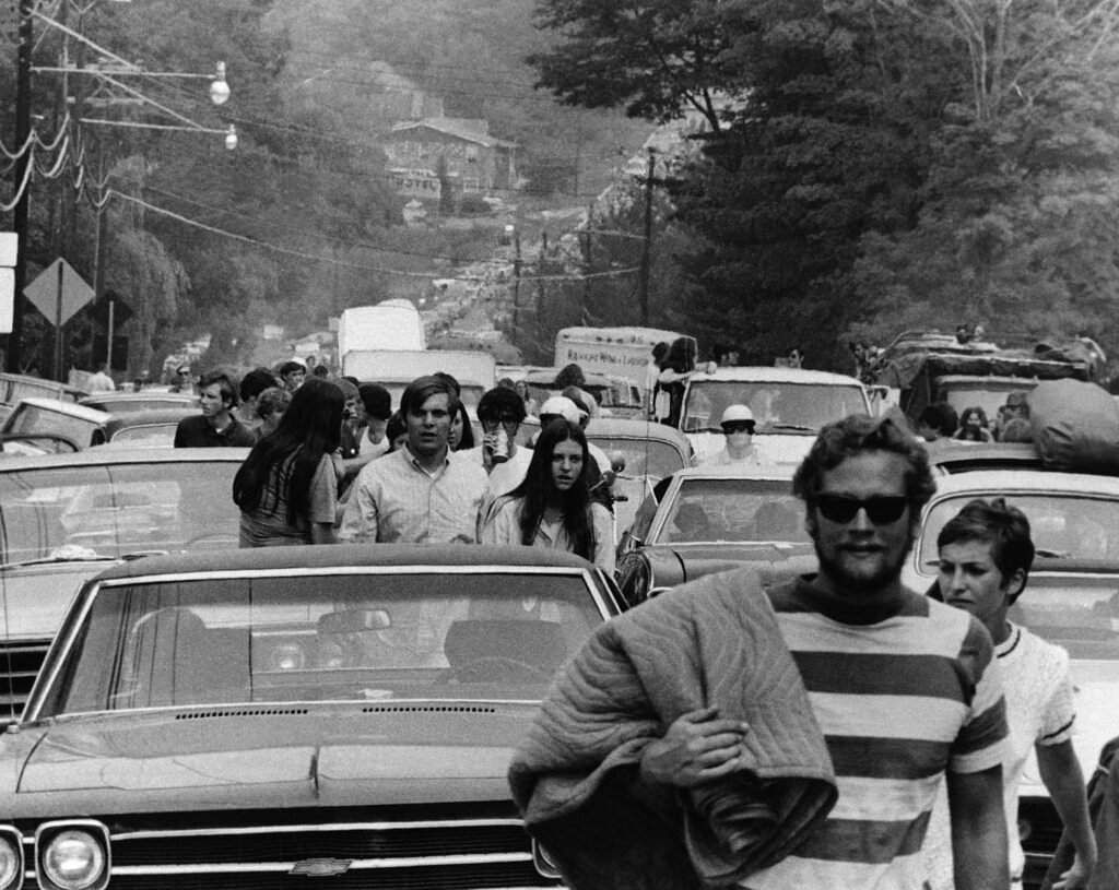 1969 file photo: People abandoned their trucks, cars and buses, backed up for 10 miles, as some 200,000 festival goers tried to reach the Woodstock Festival in Bethel, NY. (AP Photo)