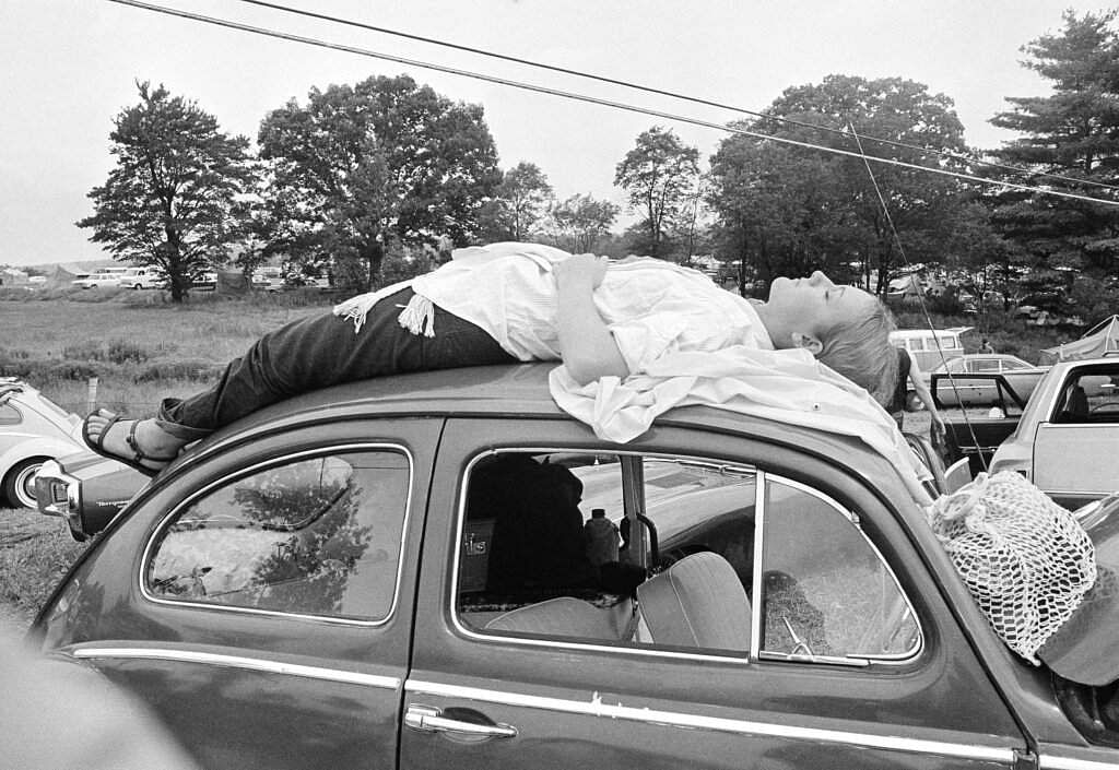 1969 file photo: A woman naps on the way to Woodstock Music and Art Festival in Bethel, NY. An estimated 400,000 people showed up for the fest on a 600-acre parcel of farmland. (AP Photo)