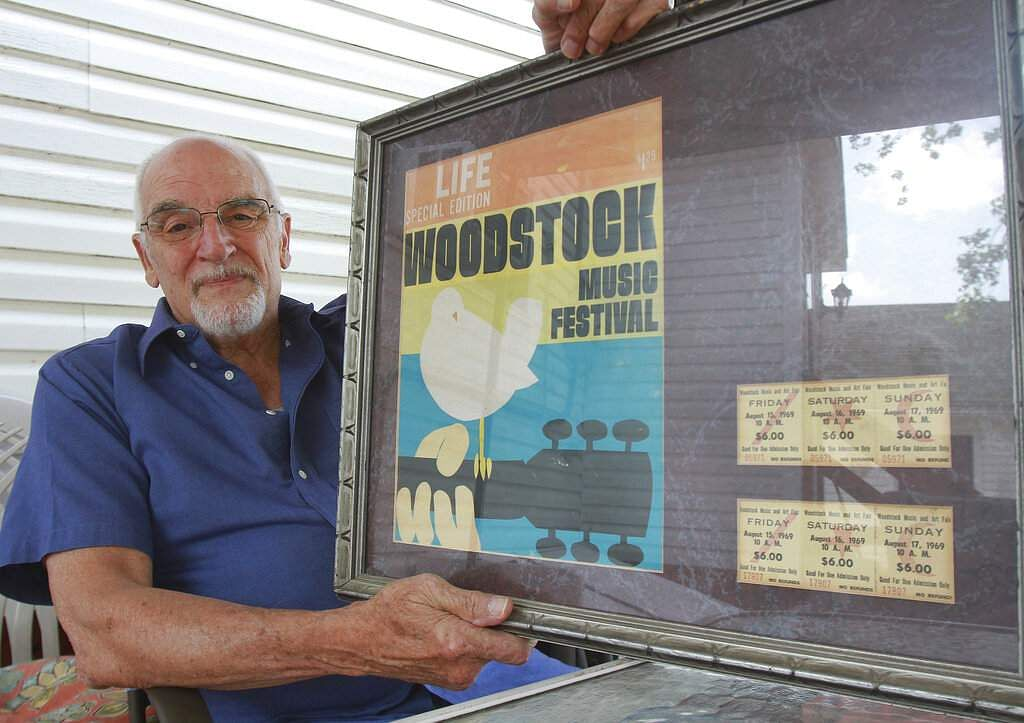Charles Vestrand, Drums, Pa., displays his framed Life special edition Woodstock magazine along with his tickets from the 1969 music festival. (Warren Ruda / Hazleton Standard-Speaker via AP)