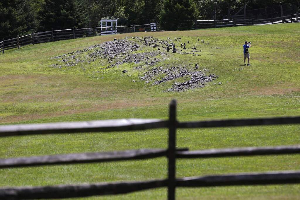 2019 photo: A flat piece of ground and rock cairns are all that remain of the stage of the 1969 Woodstock Music and Arts Fair in Bethel, NY. (AP Photo/Seth Wenig)