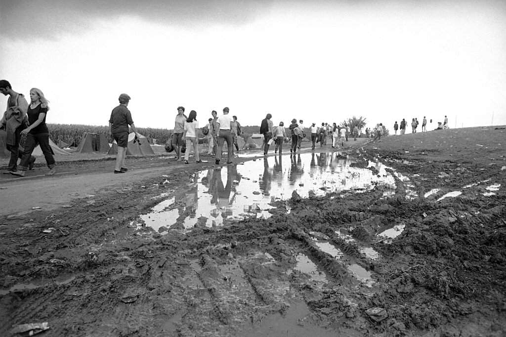 1969 file photo: Music fans hike from the Woodstock Music and Art Festival, in Bethel, NY. Some 300,000 fans began to leave as the festival ended in the rain. (AP Photo)