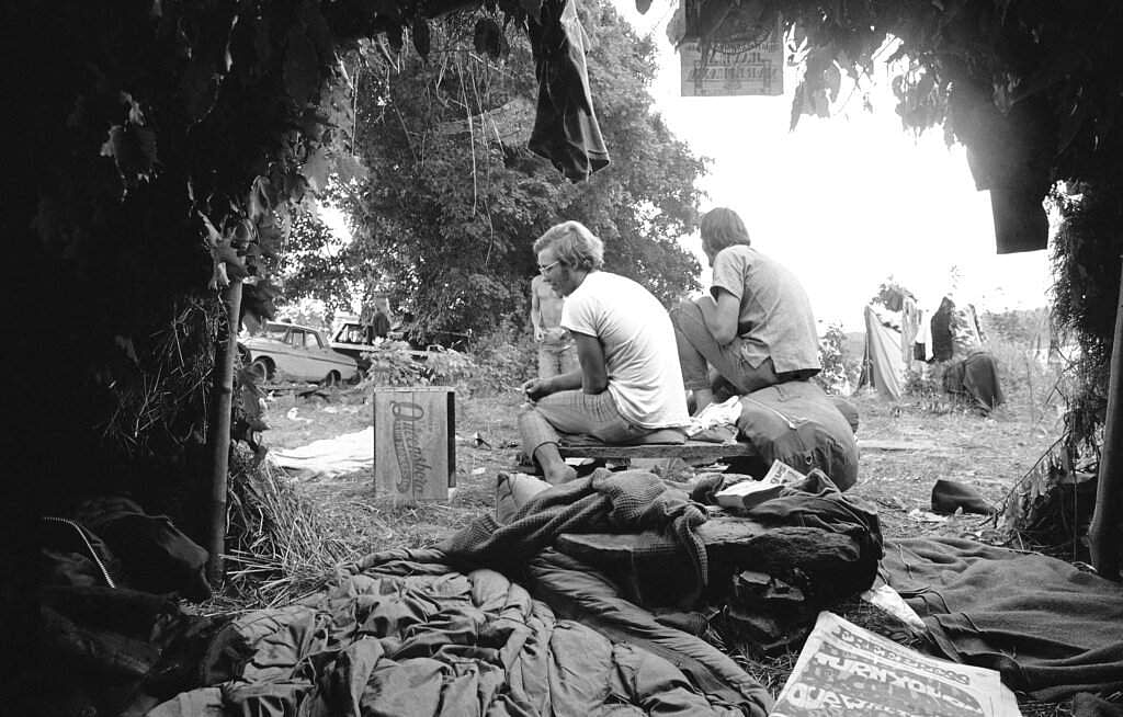 1969 file photo: Grass and leaf huts are used as makeshift living quarters for some of the attendees at the Woodstock Music and Arts Festival at White Lake in Bethel, NY. (AP Photo)
