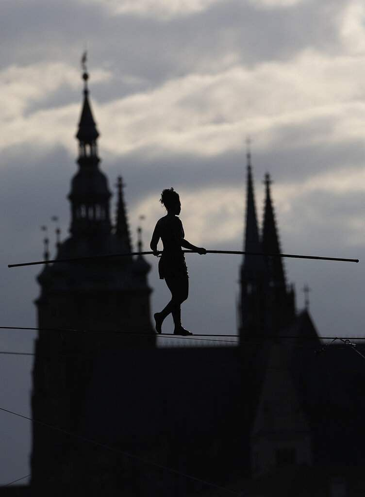 French tightrope walker Tatiana-Mosio Bongoga balances over the Vltava river to open a new circus in Prague, Czech Republic. The Prague Castle is in the background. (AP Photo/Petr David Josek)