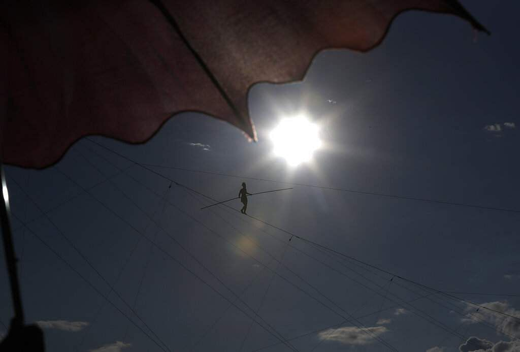 French tightrope walker Tatiana-Mosio Bongoga balances over the Vltava river during her performance to open a new circus in Prague, Czech Republic. (AP Photo/Petr David Josek)