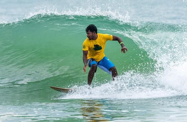 A surfer at Covelong Point Surf Music Yoga Festival