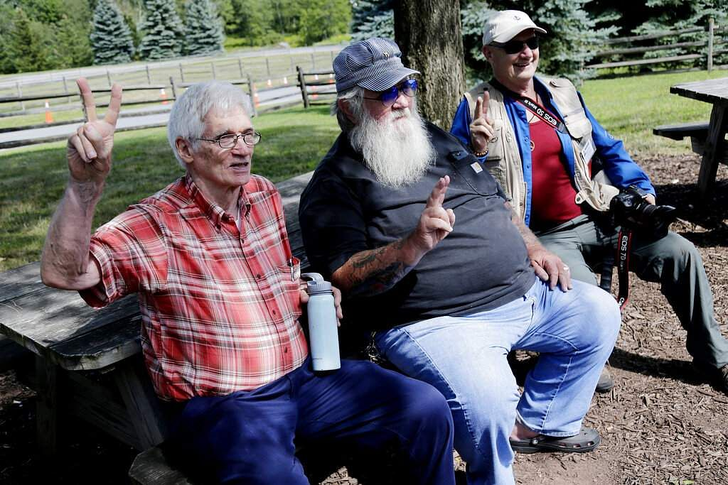 Woodstock veterans Roger Dennis, Duke Devlin and Joe Klimasiewfski pose for a picture at the original site of the 1969 Woodstock Music and Arts Fair in Bethel, NY. (AP Photo/Seth Wenig)
