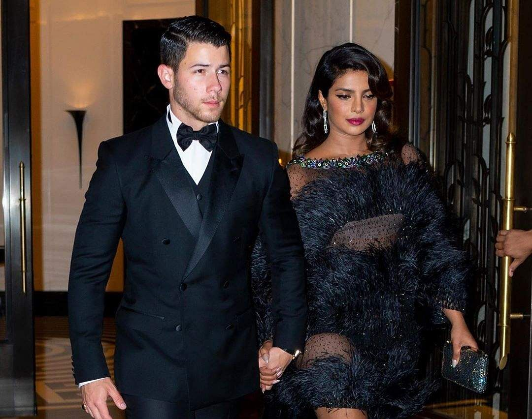 Joe Jonas marked his 30th birthday with a Bond-themed party. Priyanka Chopra and husband Nick Jonas were spotted walking hand-in-hand as they attended the party. (Photo: IANS)