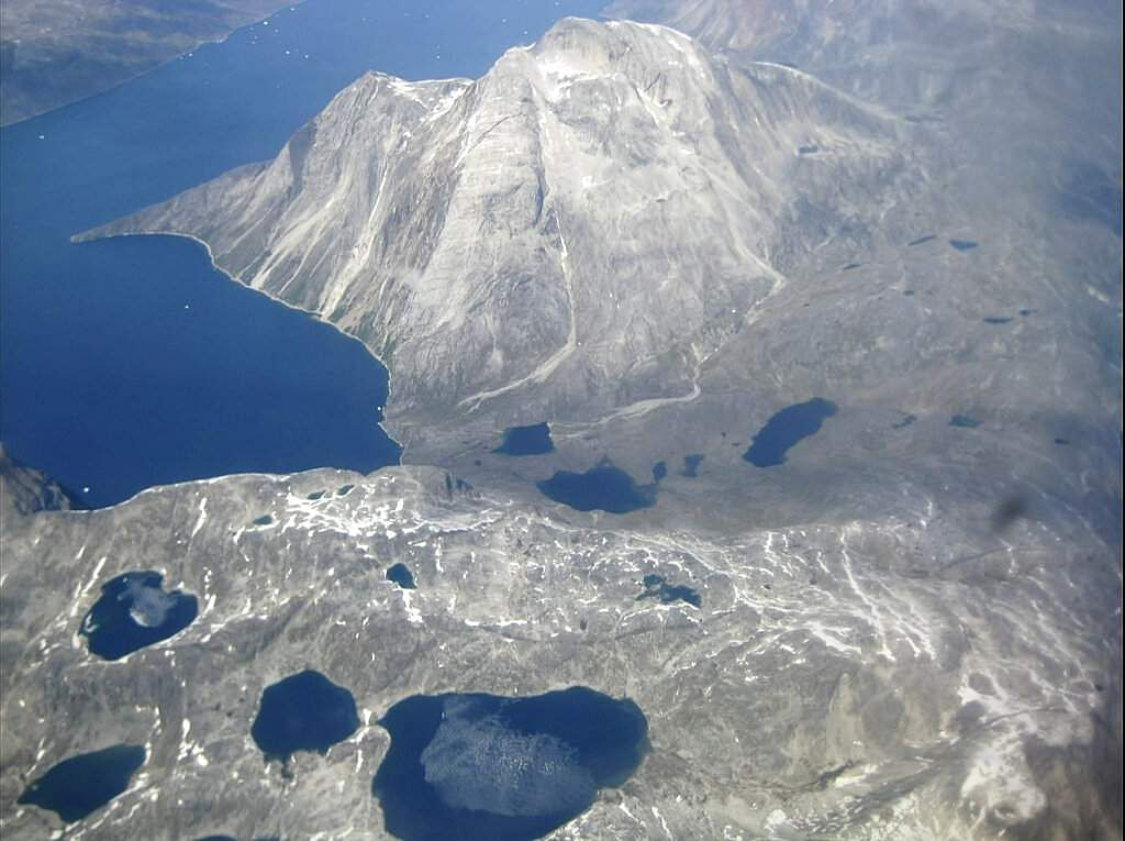 An aerial view of the edge of an ice cap in Nunatarssuk, Greenland. Milder weather than normal since the start of summer has led to concerns of increased melting of ice. (AP Photo/Sandy Virgo)