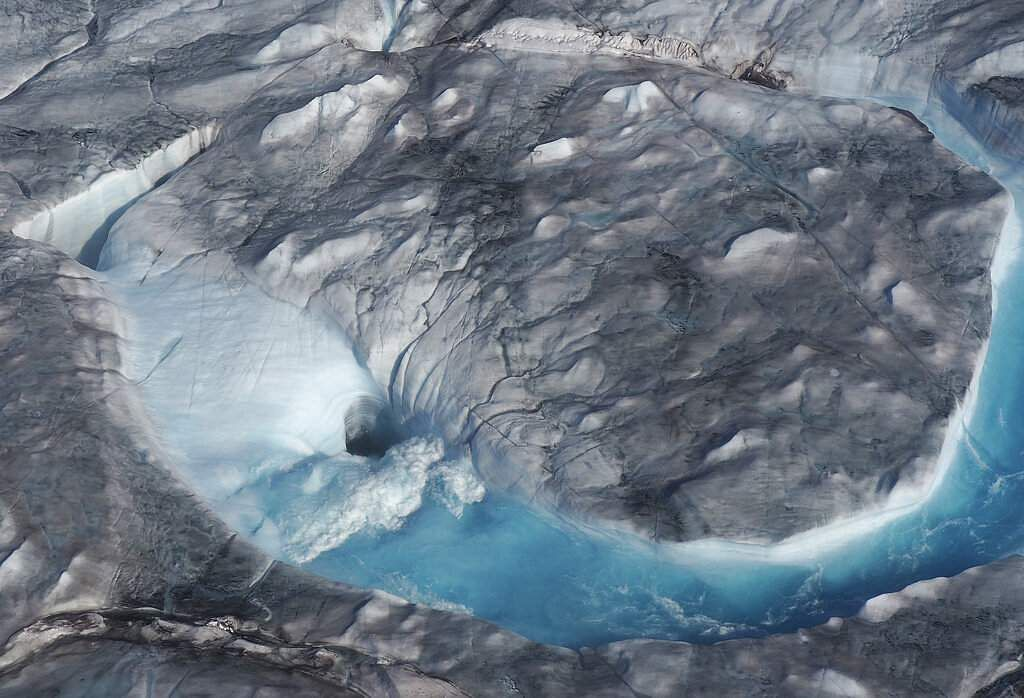 The heat wave that smashed records in five European countries a week ago is now over Greenland, speeding up the melting of the island's ice sheet. (Photo via Caspar Haarløv, Into the Ice via AP)