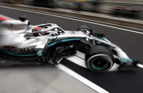 Mercedes driver Lewis Hamilton exits his pit on a practice run of the Hungarian Formula One Grand Prix at Hungaroring racetrack in Mogyorod. The Hungarian F1 GP is on Sunday. (AP Photo/Laszlo Balogh)