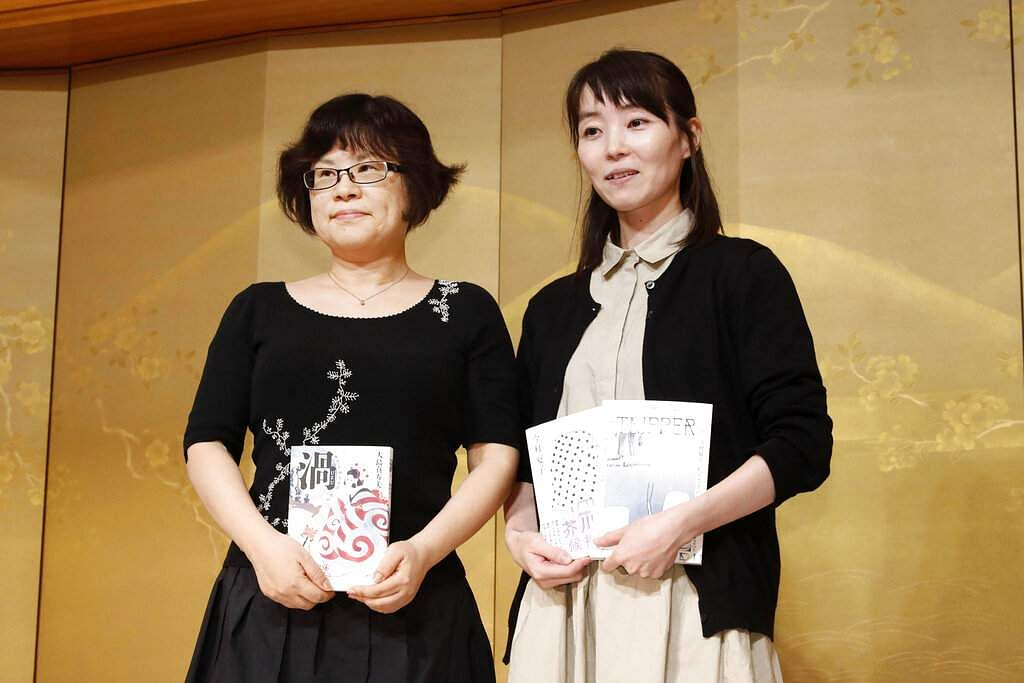 Natsuko Imamura and Masumi Oshima win the Akutagawa and Naoki Prizes. Since 1935, the prizes have recognised fiction, awarding 1 million yen and a path for translations. (Kyodo News via AP)