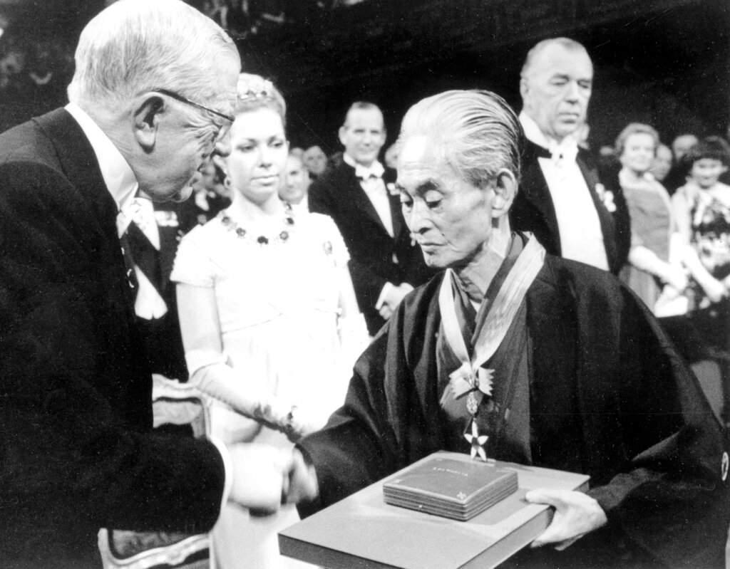 Sweden's King Gustaf VI Adolf congratulates Japanese novelist Yasunari Kawabata after presenting the Nobel Prize for literature in Stockholm, Sweden. (AP Photo)