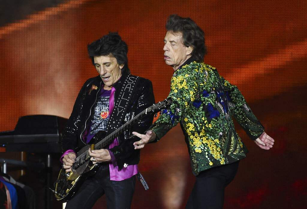 Ron Wood and Mick Jagger of the Rolling Stones perform during the band's concert at the Rose Bowl, Thursday, Aug 22, 2019, in Pasadena, Calif. (Photo by Chris Pizzello/Invision/AP)