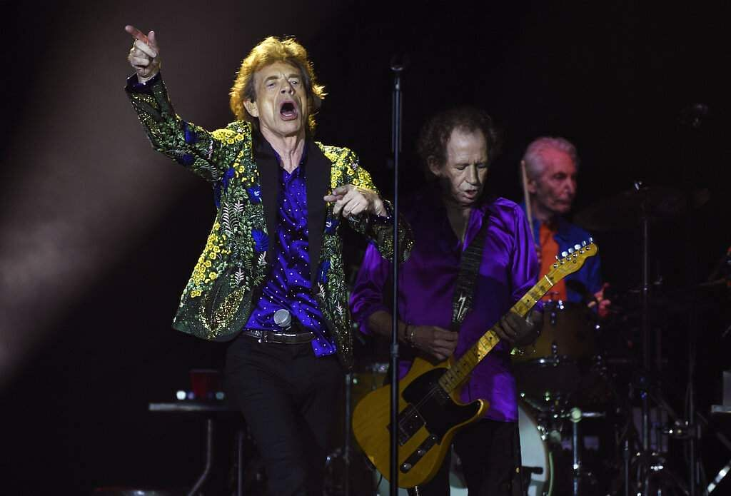 Mick Jagger of the Rolling Stones waves to the crowd during the group's concert at the Rose Bowl, Thursday, Aug. 22, 2019, in Pasadena, Calif. (Photo by Chris Pizzello/Invision/AP)