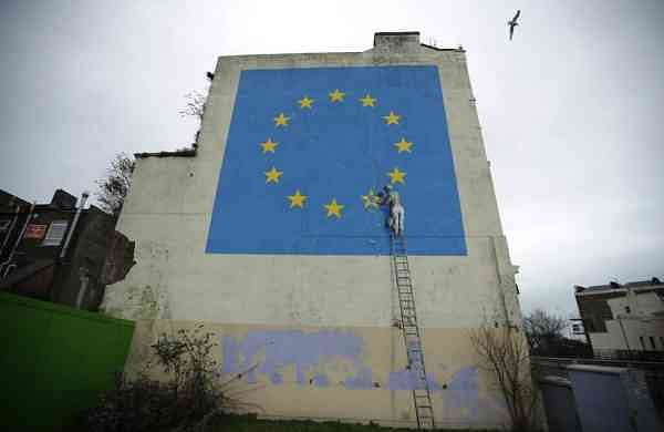 A mural by Banksy, depicting a star being chiselled from the European flag, in Dover, south east England (AP Photo/Matt Dunham)