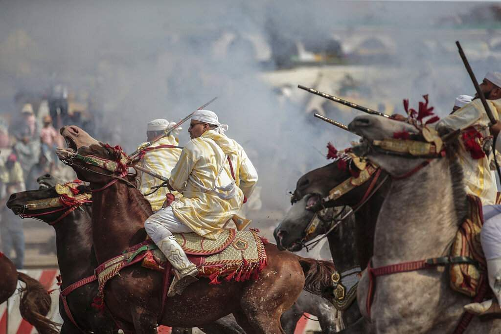 A troupe charges and fire their rifles during Tabourida, a horse riding show also known as Fantasia, in the town of El Jadida, Morocco. (AP Photo/Mosa'ab Elshamy)