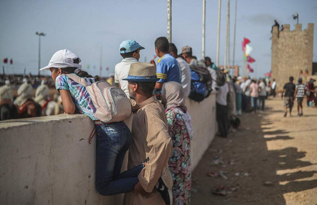 Visitors descend on the Moroccan city of El Jadida to attend the kingdom's largest equestrian show - a horseback show that combines synchronised riding with decorative guns. (AP Photo/Mosa'ab Elshamy)