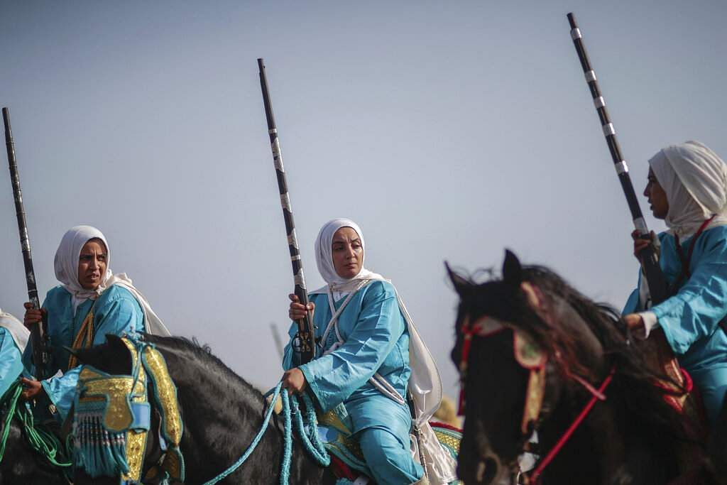 A female troupe prepares to take part in Tabourida, a traditional horse riding show also known as Fantasia, in the coastal town of El Jadida, Morocco. (AP Photo/Mosa'ab Elshamy)
