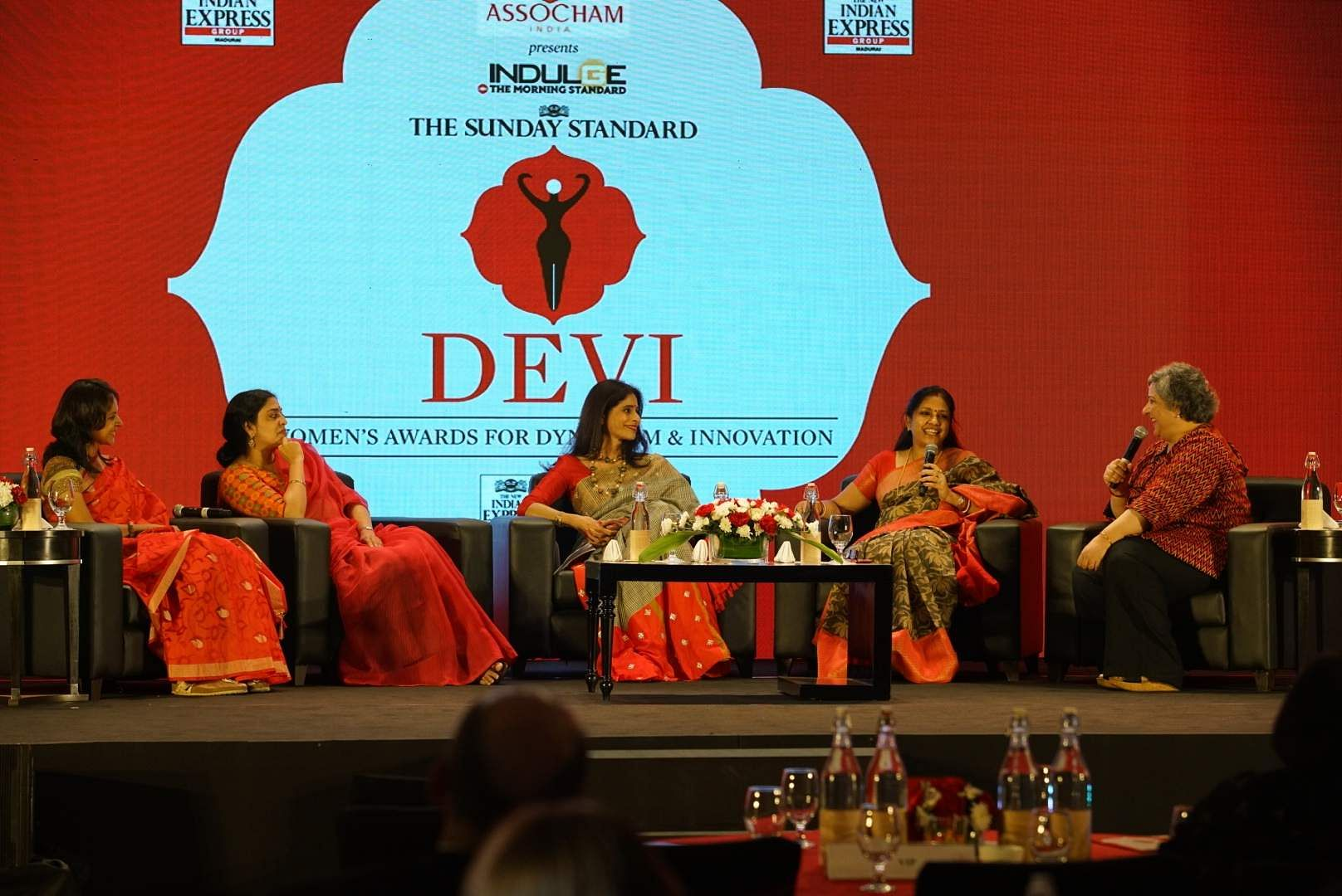 Kaveree Bamzai hosts a panel of jovial speakers at the discussion session
