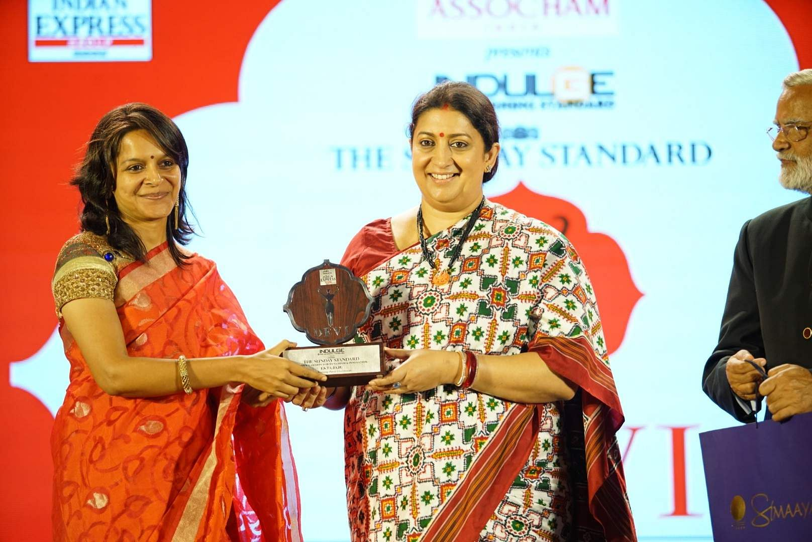 Environmental activist and entrepreneur Ekta Jaju is all smiles as she collects her award from Mrs Irani