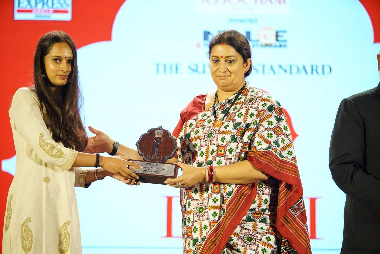 Educator and social entrepreneur Parmita Sarma receives her award from Smriti Irani