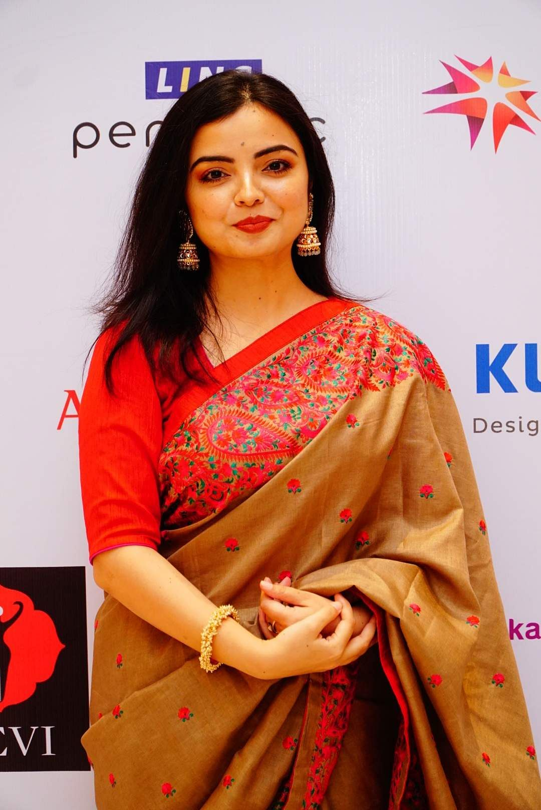 Devi Award winner and director of the acclaimed film Mukherjee Dar Bou, Pritha Chakraborty, is radiant in a sari