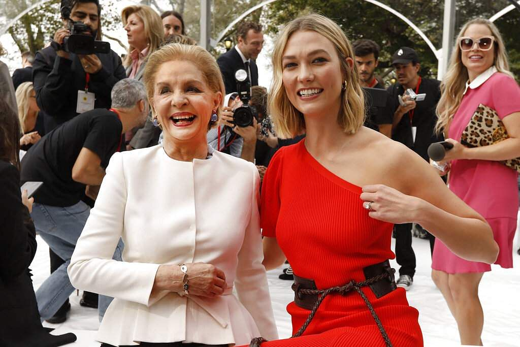 Carolina Herrera, left, poses with model Karlie Kloss before Herrera's namesake collection is modeled during Fashion Week, in New York, Monday, Sept. 9, 2019. (AP Photo/Richard Drew)
