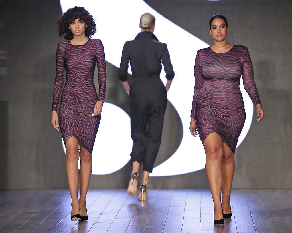 Models wear clothes by Serena Williams during Fashion Week in New York, Tuesday, Sept. 10, 2019. (AP Photo/Seth Wenig)