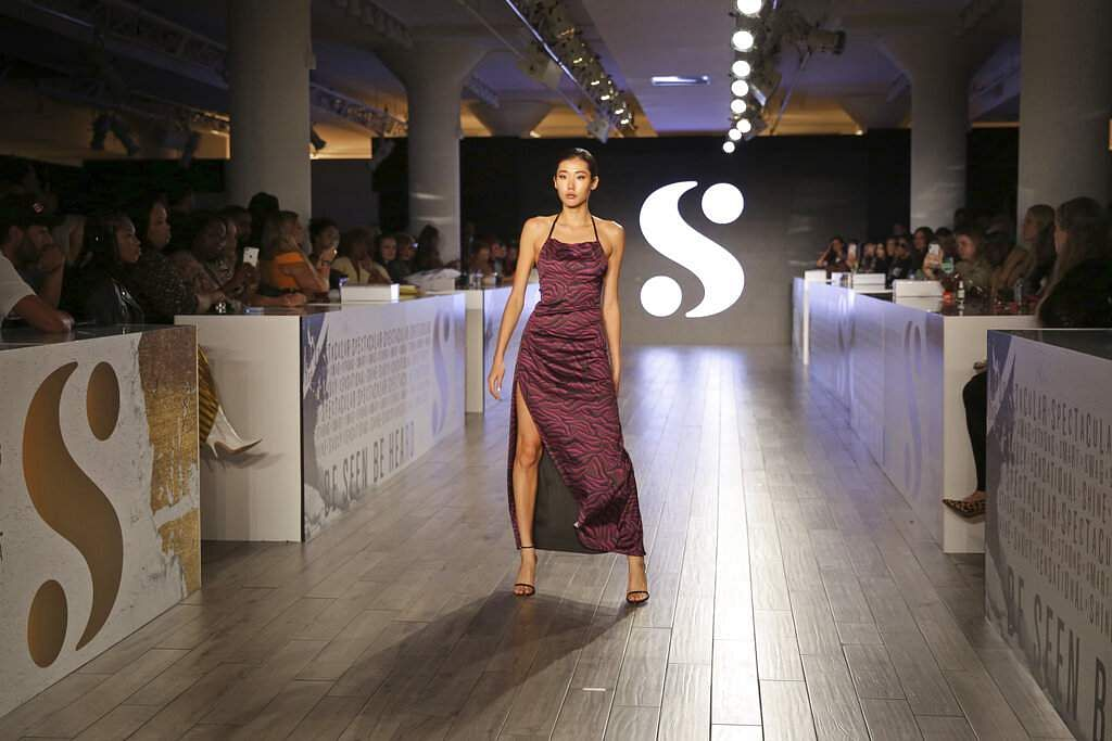 A model wears clothes by Serena Williams during Fashion Week in New York, Tuesday, Sept. 10, 2019. (AP Photo/Seth Wenig)