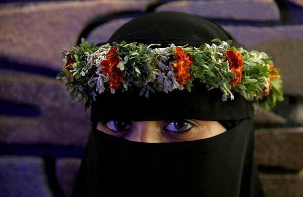 A Saudi woman wears a colourful crown native to the village of Rijal Almaa, at the al-Soudah festival, in Abha, southwest Saudi Arabia. (AP Photo/Amr Nabil)