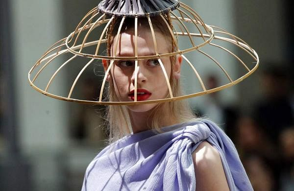 A model wears a creation as part of the Issey Miyake Ready To Wear Spring-Summer 2020 collection, unveiled during the fashion week, in Paris, Friday, Sept. 27, 2019. (AP Photo/Francois Mori)