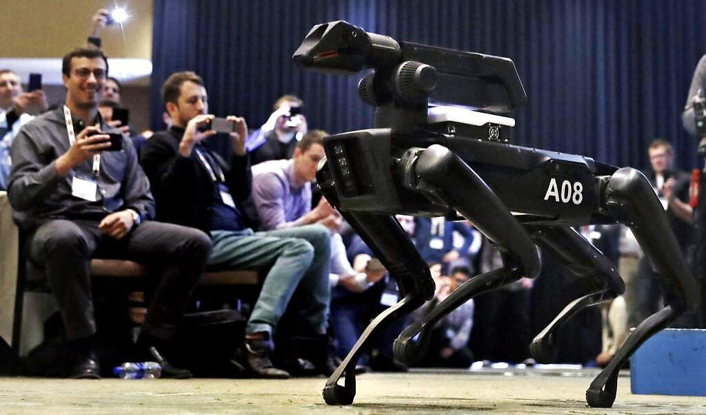 2018 file: A Boston Dynamics SpotMini robot (AP Photo/Charles Krupa)