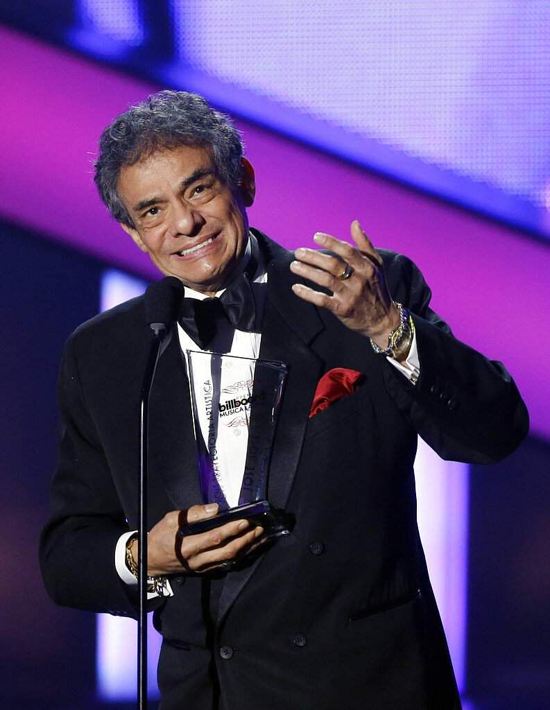 2013 file: Jose Jose receives the Billboard Lifetime Achievement Award at the Latin Billboard Awards in Coral Gables, Fla. The Mexican crooner died on Sep 28, 2019. He was 71. (AP Photo/Alan Diaz)