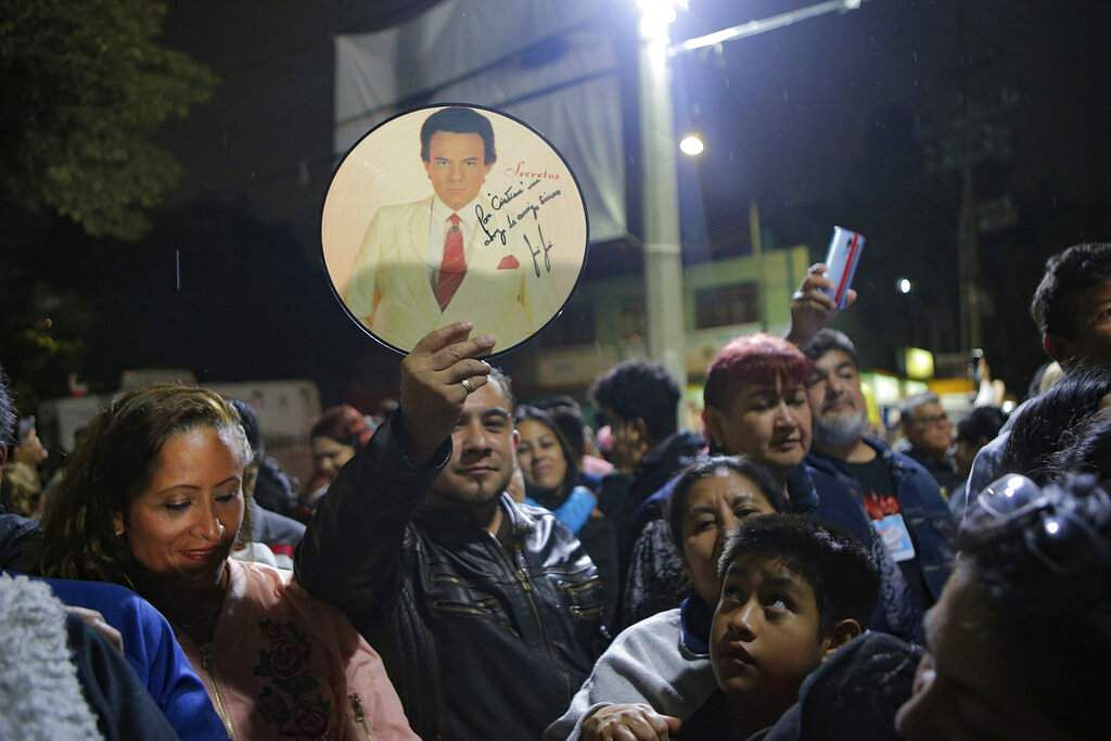 Fans gather to sing and remember Jose Jose to mourn his death at José José's statue in Mexico City. Mexican crooner José José, known as the 'Prince of Song,' died at age 71. (AP Photo/Anthony Vazquez)