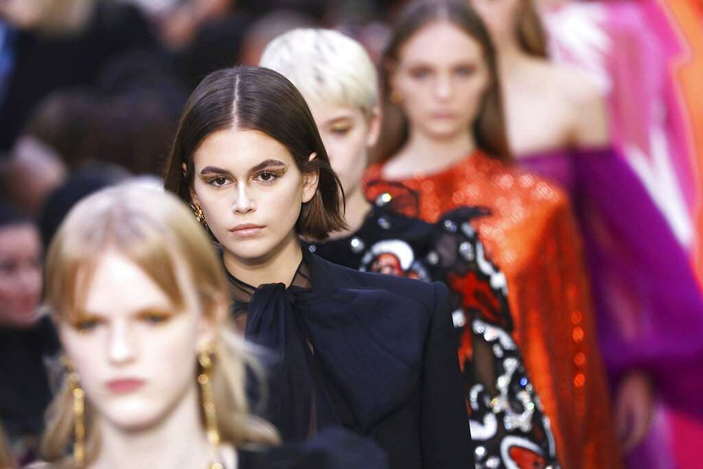 Model Kaia Gerber walks with other models as they wear creations as part of the Valentino Ready To Wear Spring-Summer 2020 collection. (Photo by Vianney Le Caer/Invision/AP)